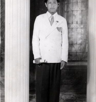 Portrait of Cesar Chavez taken at his 8th grade graduation, 1942. This was his final year of formal schooling before he went to work in the fields full time.