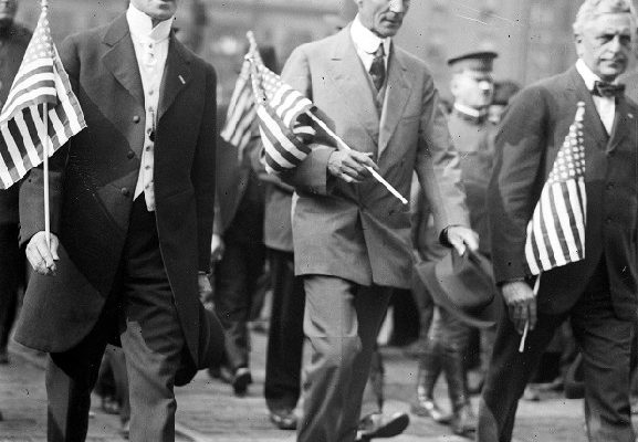 Henry Ford marches with Oscar Marx through the streets of downtown Detroit during the draft parade, circa 1914